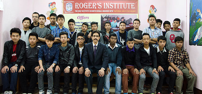 Mr. Claudius Singh Rasaily with students